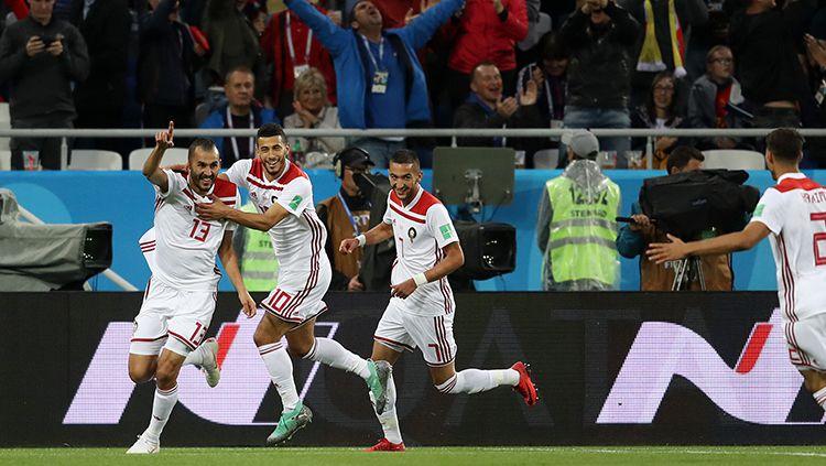 Para pemain Maroko merayakan gol yang dicetak ke gawang Spanyol. Copyright: © INDOSPORT
