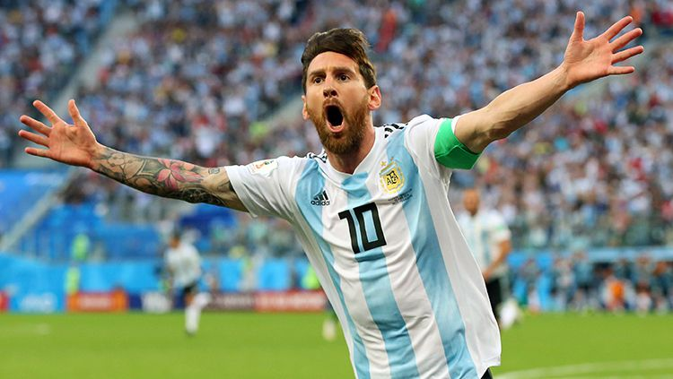 Lionel Messi merayakan gol yang dicetaknya ke gawang Nigeria. Copyright: © Getty Images