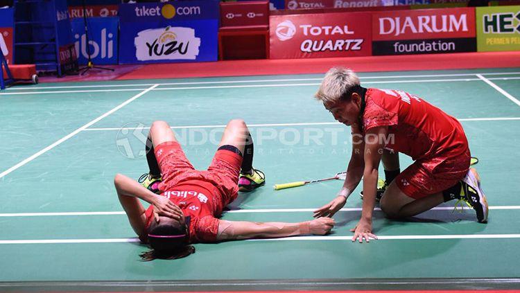 Greysia Polii/Apriyani Rahayu saat kalah dari pasangan Jepang di Indonesian Open 2018. Copyright: © Herry Ibrahim/INDOSPORT