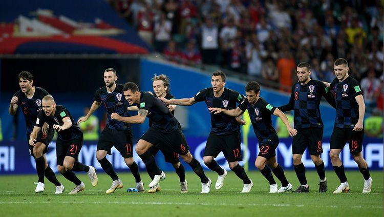 Kroasia merayakan kemenangan lewat drama adu penalti melawan Rusia di Piala Dunia 2018. Copyright: © Getty Images