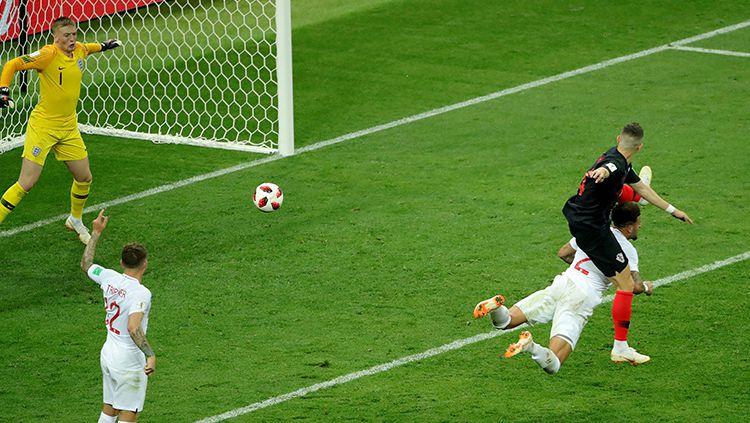 Ivan Perisic mencetak gol yang membuat Kroasia menyamakan kedudukan atas Inggris di semifinal Piala Dunia 2018. Copyright: © INDOSPORT
