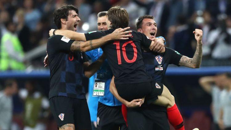 Selebrasi pemain Kroasia, Mario Mandzukic mencetak gol kedua yang membuat Kroasia unggul atas Inggris. Copyright: © Indosport.com