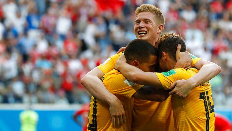 Kevin de Bruyne merayakan gol yang dicetak kapten Belgia Eden Hazard ke gawang Inggris di Piala Dunia 2018. Copyright: © Getty Images