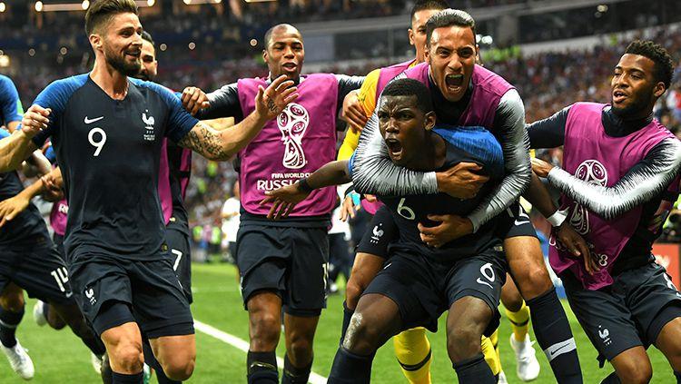 Para pemain Prancis merayakan gol yang dicetak oleh Paul Pogba. Copyright: © INDOSPORT