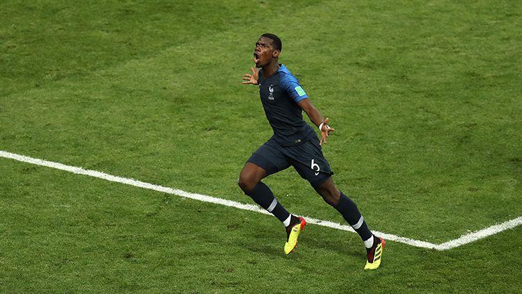 Paul Pogba merayakan gol yang dicetaknya ke gawang Kroasia. Copyright: © Getty Images