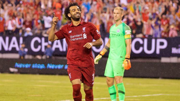 Mohamed Salah usai cetak gol dalam laga Man City vs Liverpool di ICC 2018. Copyright: © Twitter/Liverpool