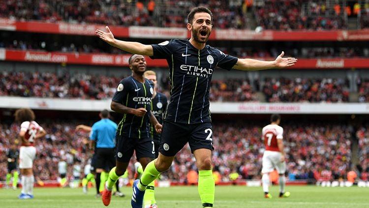 Bernardo Silva mencetak gol kedua bagi Man City saat mengalahkan Arsenal. Copyright: © Getty Images/Michael Regan