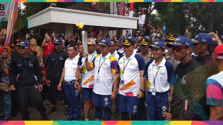 Usai Lalui Perjalanan Panjang, Kirab Obor Asian Games Tiba di Kota Bogor. Copyright: © Zainal Hasan/Indosport.com