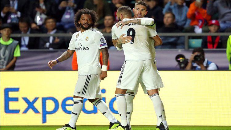 Meski berhasil mengalahkan Barcelona 3-1 di LaLiga Spanyol pekan lalu, Sergio Ramos kedapatan mengamuk pada dua pemain senior Real Madrid, Isco dan Marcelo. Copyright: © Getty Images