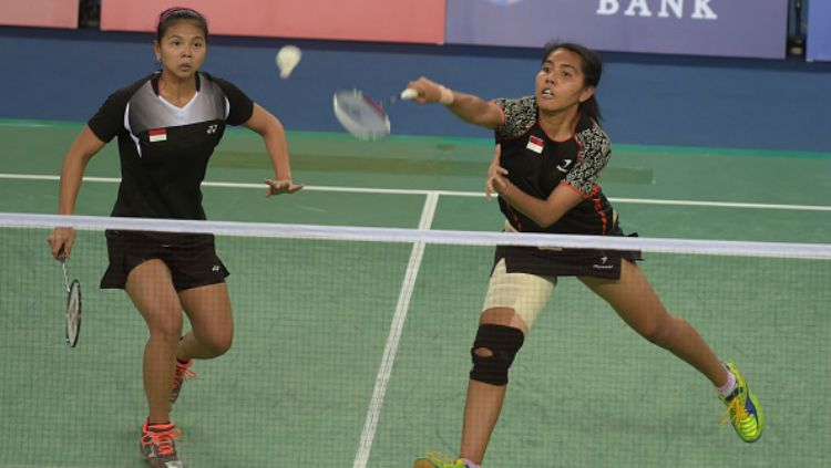 Greysia Polii/Nitya Krishinda Maheswari di Asian Games 2014. Copyright: © PORNCHAI KITTIWONGSAKUL/AFP/Getty Images