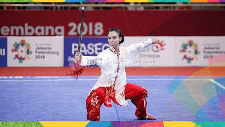 Atlet wushu Indonesia, Lindswell Kwok berhasil meraih medali emas Asian Games 2018. Copyright: © INDOSPORT/Herry Ibrahim