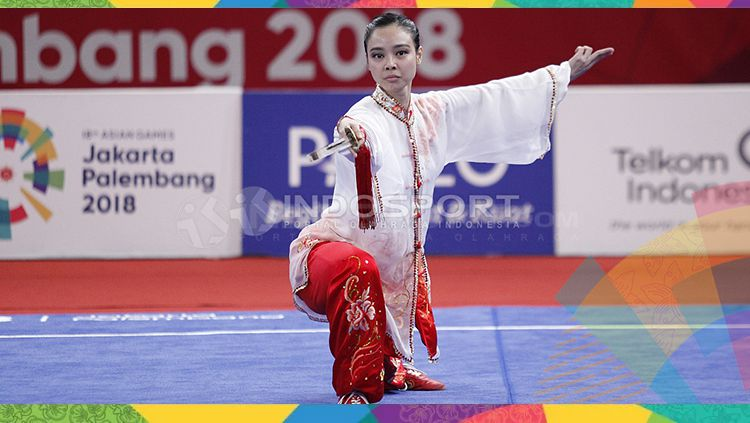 Atlet wushu Indonesia, Lindswell Kwok sabet medali emas Asian Games 2018. Copyright: © INDOSPORT/Herry Ibrahim