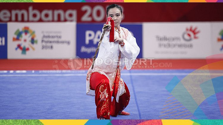Atlet wushu Indonesia, Lindswell Kwok sabet medali emas Asian Games 2018. Copyright: © INDOSPORT/Herry Ibrahim