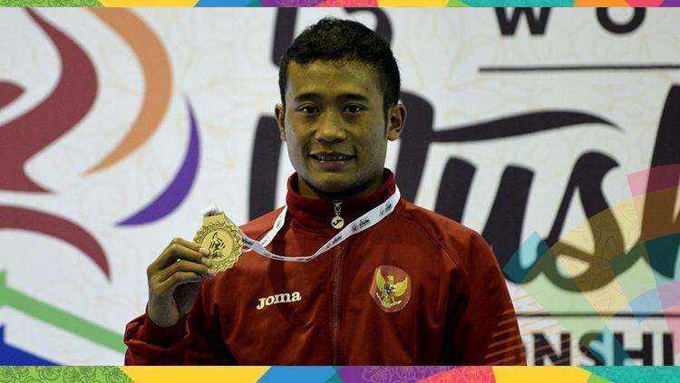 Yusuf Widiyanto, perebut medali perunggu di Asian Games 2018 di cabor wushu nomor Sanda 56 kg. Copyright: © Sigid Kurniawan/Antara Foto