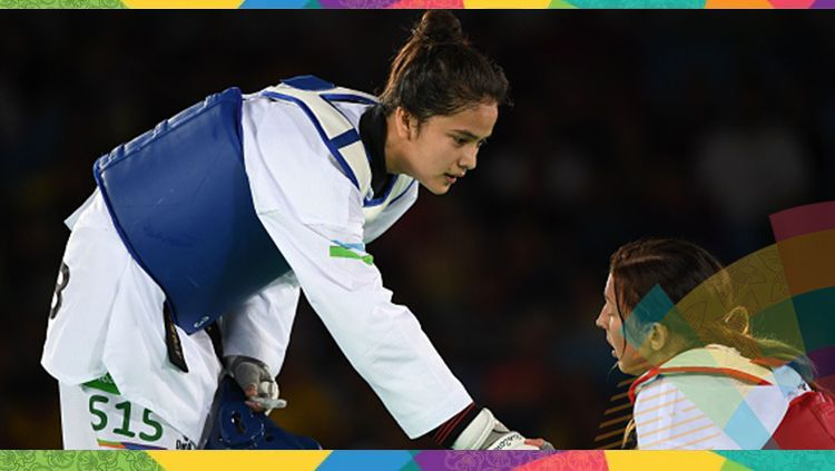 Atlet taekwondo, Nigora Tursunkulova (kiri) Copyright: © Getty Images/KIRILL KUDRYAVTSEV