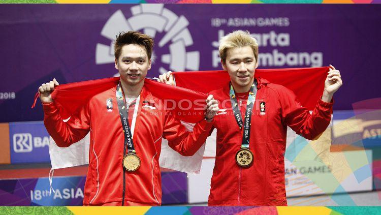 Kevin Sanjaya/Markus Fernaldi Gideon sabet medali emas cabor bulutangkis ganda putra Asian Games 2018. Copyright: © Herry Ibrahim/INDOSPORT