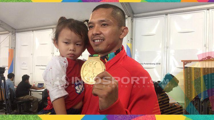 Nofrizal, atlet sepak takraw putra Indonesia, persemabahkan emas untuk anaknya yang meninggal dunia. Copyright: © INDOSPORT/Lanjar Wiratri