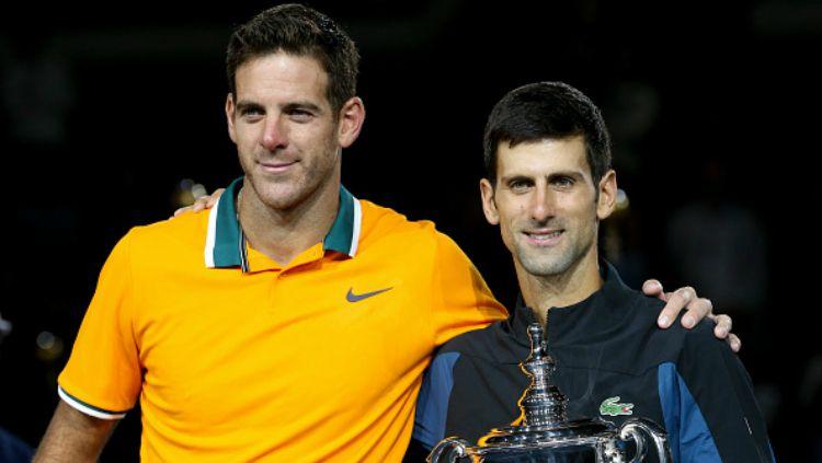 Juan Martin del Porto (kiri) bersama Novak Djokovic usai laga final AS Terbuka 2018. Copyright: © INDOSPORT
