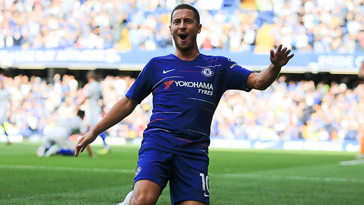 Eden Hazard berselebrasi usai mencetak gol ke gawang Cardiff City. Copyright: © Getty Images/Marc Atkins
