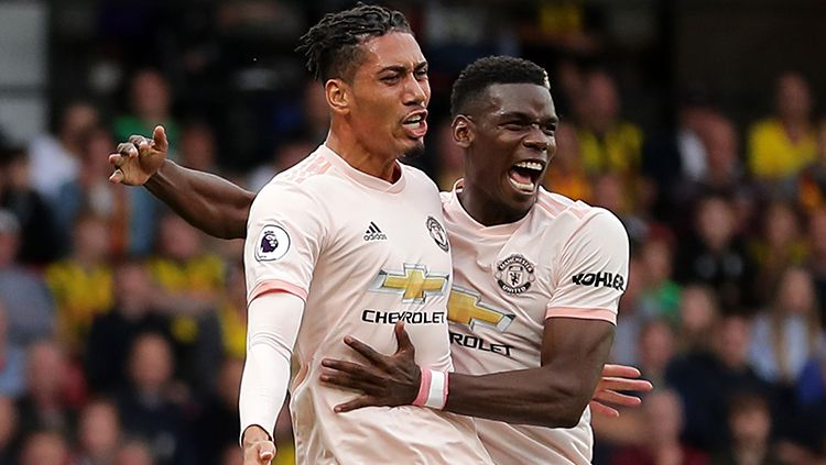 Chris Smalling berselebrasi usai menggandakan keunggulan Manchester United atas Watford. Copyright: © Getty Images/Richard Heathcote