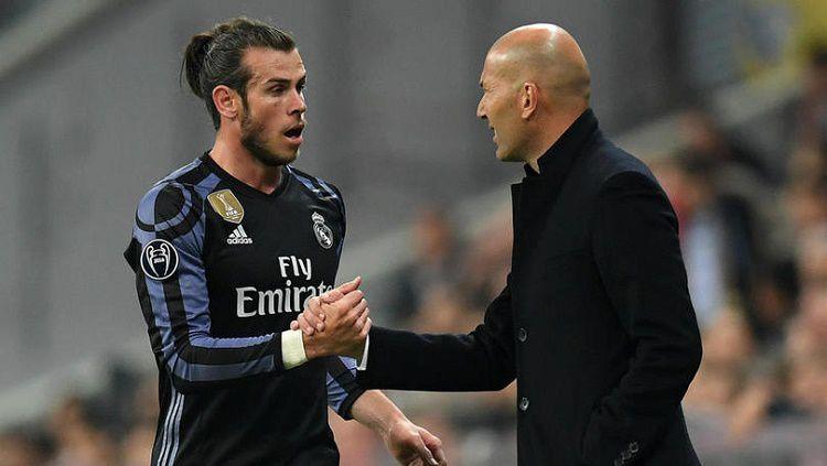 Gareth Bale dan Zinedine Zidane pernah dirumorkan sempat bersitegang satu sama lain. Copyright: © fourfourtwo