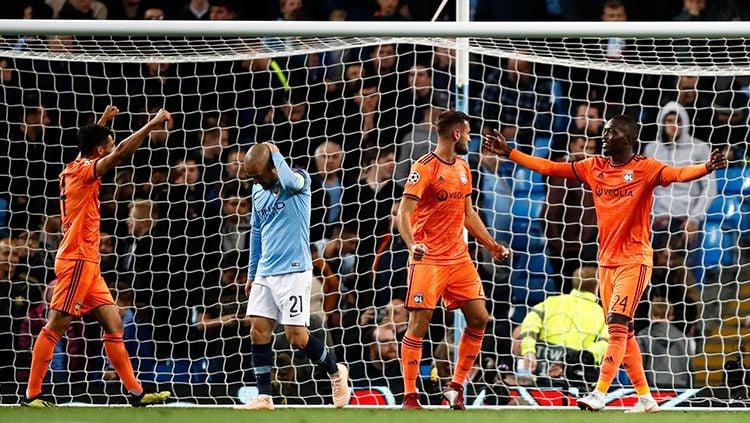 Selebrasi pemain Lyon usai mengalahkan Manchester City dalam laga Liga Champions 2018/19. Copyright: © INDOSPORT
