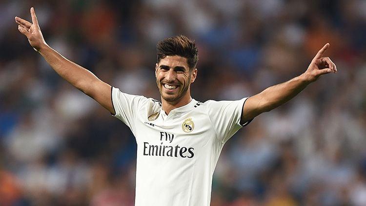 Marco Asensio berselebrasi usai mencetak gol ke gawang Copyright: © Getty Images