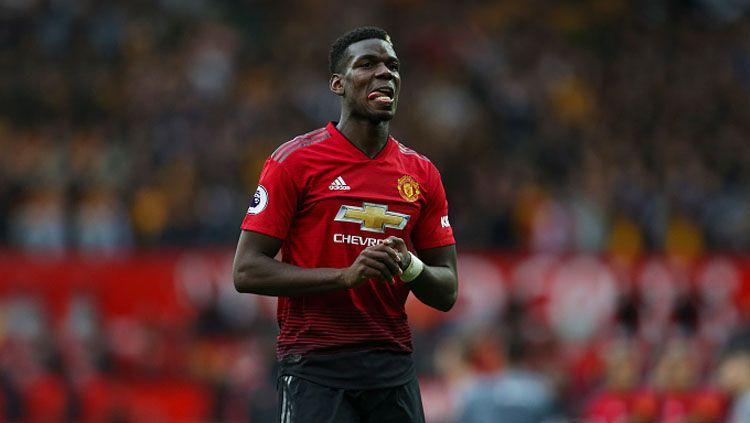 Gelandang Manchester United, Paul Pogba, masih harus menjalani proses pemulihan setelah cedera. Copyright: © Getty Images