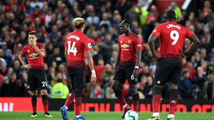 Para pemain Man United tampak sedih. Copyright: © INDOSPORT