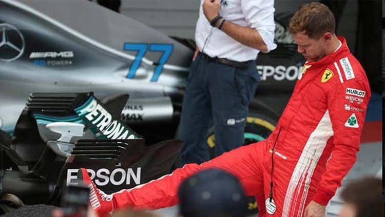 Sebastian Vettel sempat merasa jengkel saat gelaran F1 GP Kanada 2019 akibat insiden yang membuatnya menjadi juara kedua di belakang Lewis Hamilton. Copyright: © Express UK
