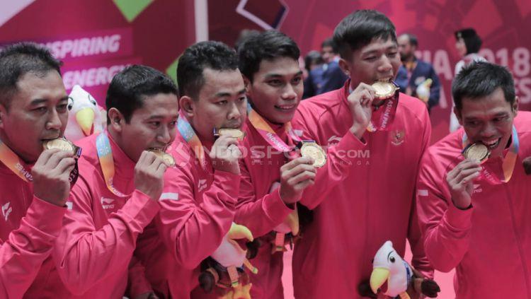Perolehan Medali Emas, final beregu bulutangkis Indonesia vs Malaysia Asian Para Games 2018. Copyright: © Roihan Susilo Utomo/Indosport.com
