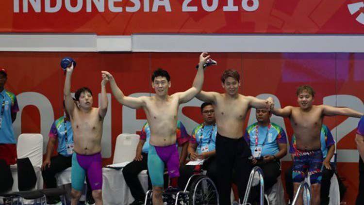 Atlet renang putra Korea Bersatu yang meraih perunggu sebagai medali pertama mereka di turnamen Asian Para Games 2018. Copyright: © Yonhap