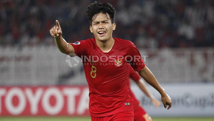 Witan Sulaeman saat berselebrasi selepas mencetak gol ke gawang UEA U-19. Copyright: © Herry Ibrahim/INDOSPORT