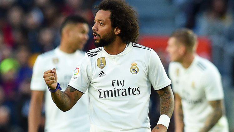 Marcelo berselebrasi usai mencetak gol ke gawang Barcelona di pekan ke-10 La Liga 2018/19. Copyright: © Getty Images/Alex Caparros