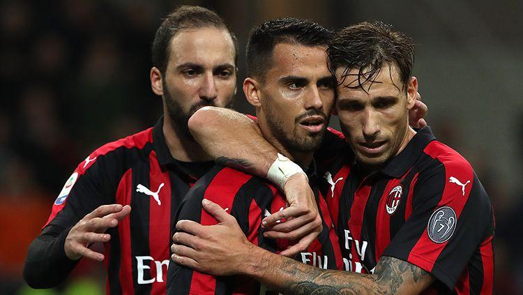 Suso (tengah) kabarnya akan dijadikan 'tumbal' AC Milan demi mendatangkan pemain Atletico Madrid, Angel Correa. Copyright: © Getty Images/Marco Luzzani