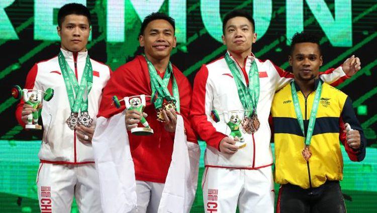 Eko Yuli juara dunia kejuaraan angkat besi di Turkmenistan. Copyright: © IWF.com