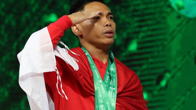 Eko Yuli juara dunia kejuaraan angkat besi di China. Copyright: © IWF.com
