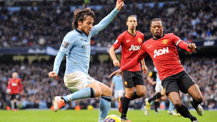 Pep Guardiola menyatakan jika David Silva bakal bertahan di Etihad dan akan bermain untuk Manchester City sampai akhir musim 2019/20 ini. Copyright: © Getty Images