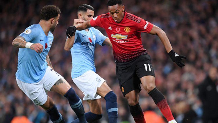 Berikut tersaji prediksi pertandingan derbi sepak bola semifinal Piala Liga Inggris 2019-2020 antara Manchester City vs Manchester United di Etihad Stadium. Copyright: © Laurence Griffiths/Getty Images
