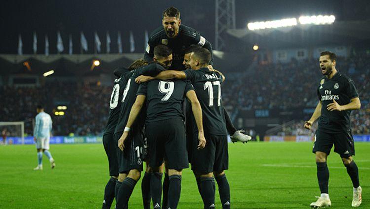 Para pemain Real Madrid usai mencetak gol ke gawang Celta Vigo. Copyright: © Octavio Passos/Getty Images
