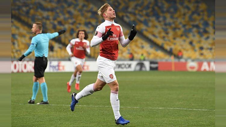 Emile Smith Rowe merayakan gol saat partai Vorskla vs Arsenal di Liga Europa, Jumat (30/11/18). Copyright: © Getty Images