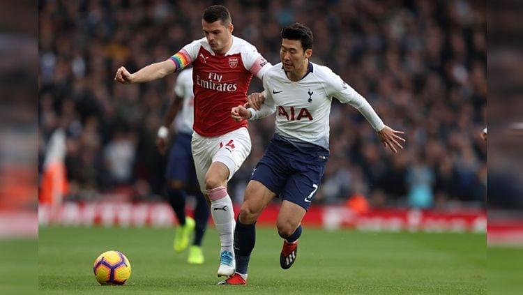 Arsenal dikabarkan tengah membidik tiga bintang anyar yang akan didatangkan di bursa transfer musim panas mendatang untuk menggantikan peran dan posisi Granit Xhaka di lini tengah. Copyright: © Getty Images