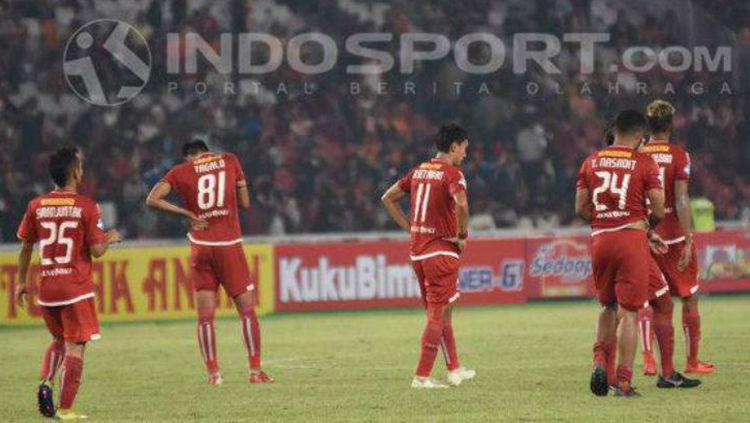 Pemain Persija Jakarta tertunduk lesu Copyright: © INDOSPORT