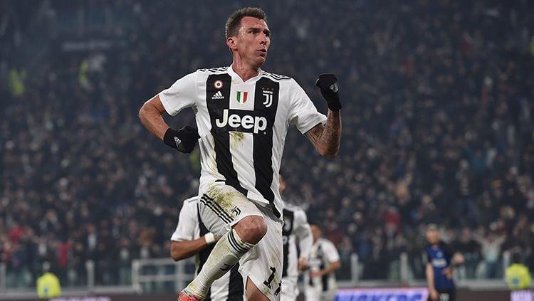 Selebrasi Mandzukic setelah membobol gawang Inter Milan. Copyright: © Getty Images