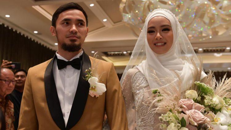 Pernikahan dua atlet wushu Indonesia, Lindswell Kwok dan Achmad Hulaefi. Copyright: © Humas Kemenpora
