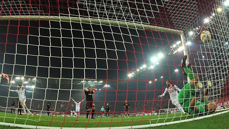 Suasana pertandingan Olympiakos vs AC Milan di Liga Europa. Copyright: © INDOSPORT