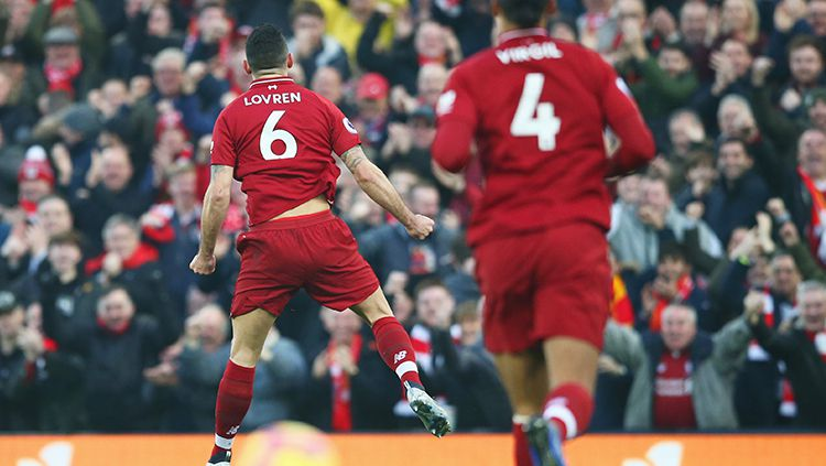 Dejan Lovren berselebrasi usai membuka keunggulan Liverpool atas Newcastle. Copyright: © Jan Kruger/Getty Images