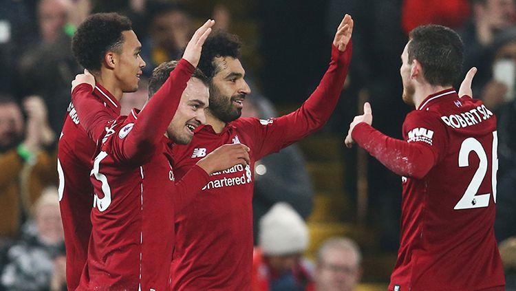 Mohamed Salah berselebrasi usai mencetak gol ke gawang Newcastle. Copyright: © Jan Kruger/Getty Images