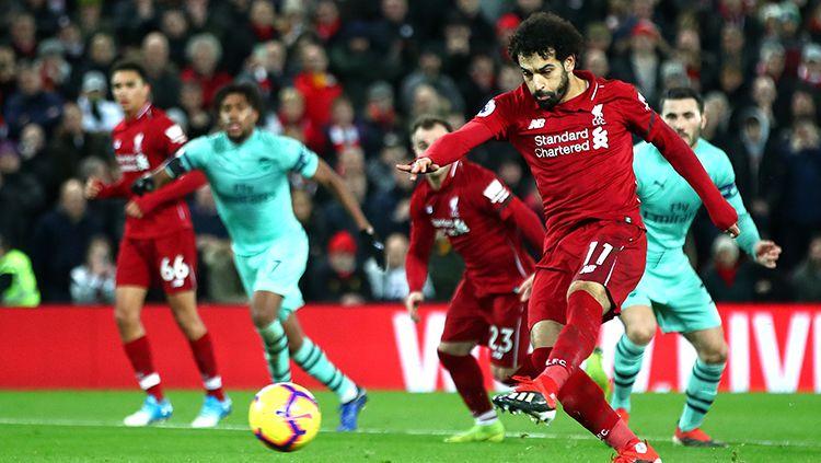 Mohamed Salah saat mencetal gol dari titik penalti. Copyright: © Getty Images