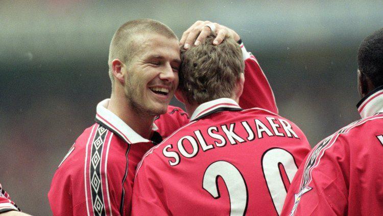 David Beckham dan Ole Gunnar Solskjaer saat masih menjadi pemain Manchester United. Copyright: © Getty Images